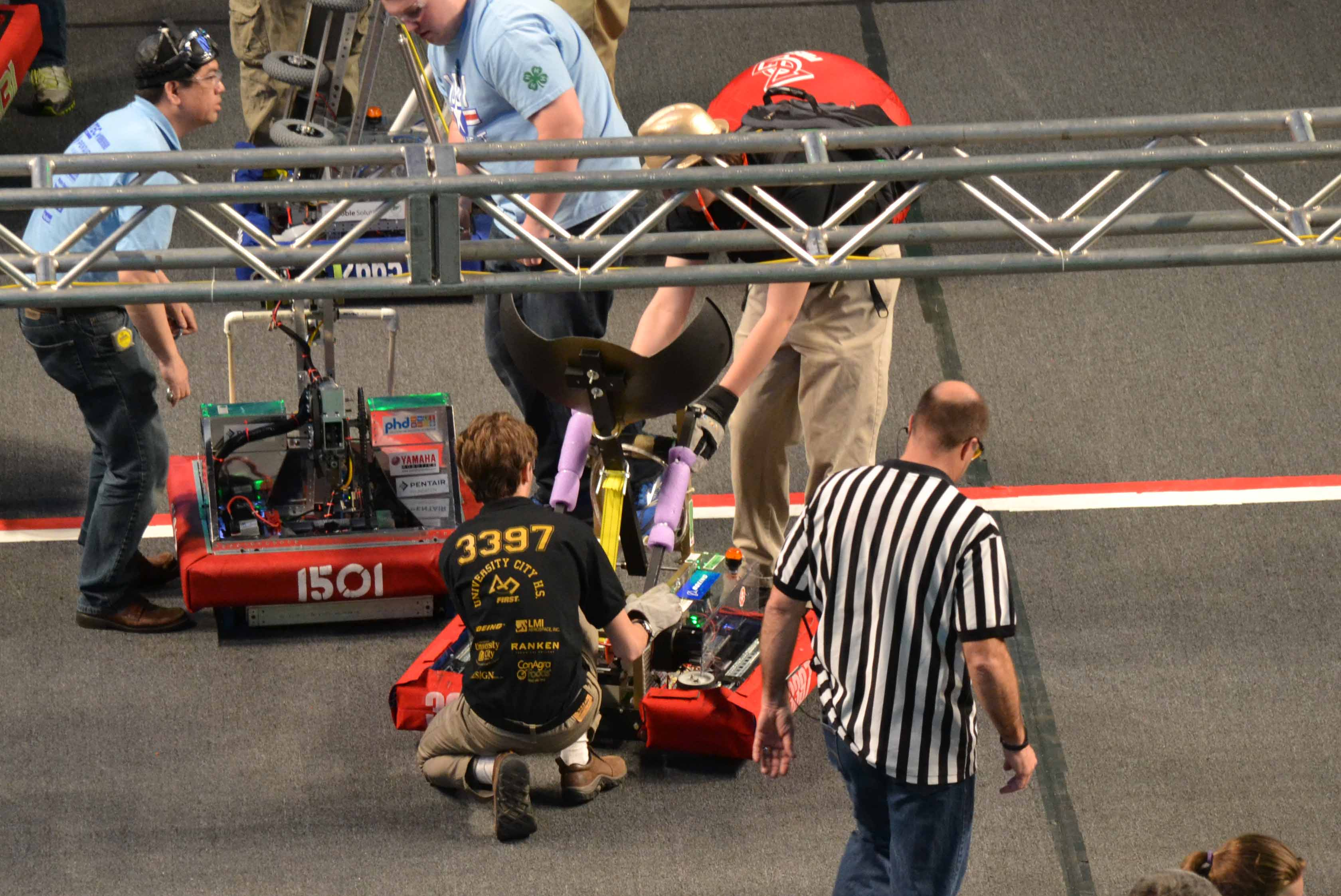 Joshua Stueck, driver and programmer, and Walter Deitzler, captain, set up the robot before a match.