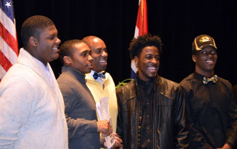Football players sign with colleges for National Signing Day