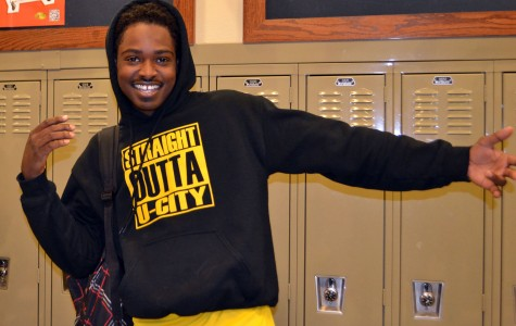 "Thompson Brown, senior, reps his ""Straight Outta U City"" hoodie on Oct. 30 in the hallway. ""The theme of the shirts was a great idea since 'Straight Outta Compton' was a popular movie this year,"" said Brown."