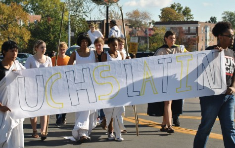 "For the first time, Latin Club walks with a float in the parade. ""Students took the lead with our float,"" said Matthew Tuths, Latin teacher. ""We built a mini Mt. Olympus."""