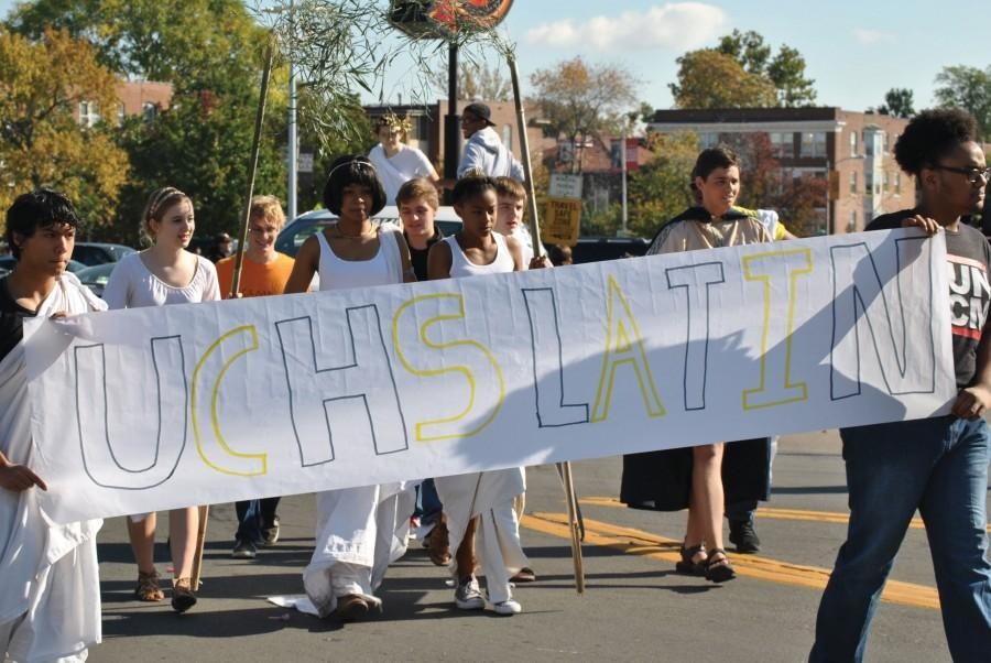 """For the first time, Latin Club walks with a float in the parade. """"Students took the lead with our float,"""" said Matthew Tuths, Latin teacher. """"We built a mini Mt. Olympus."""""""