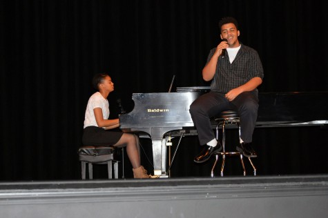 Joshua Mayfield, senior, sings as an act for the talent show.