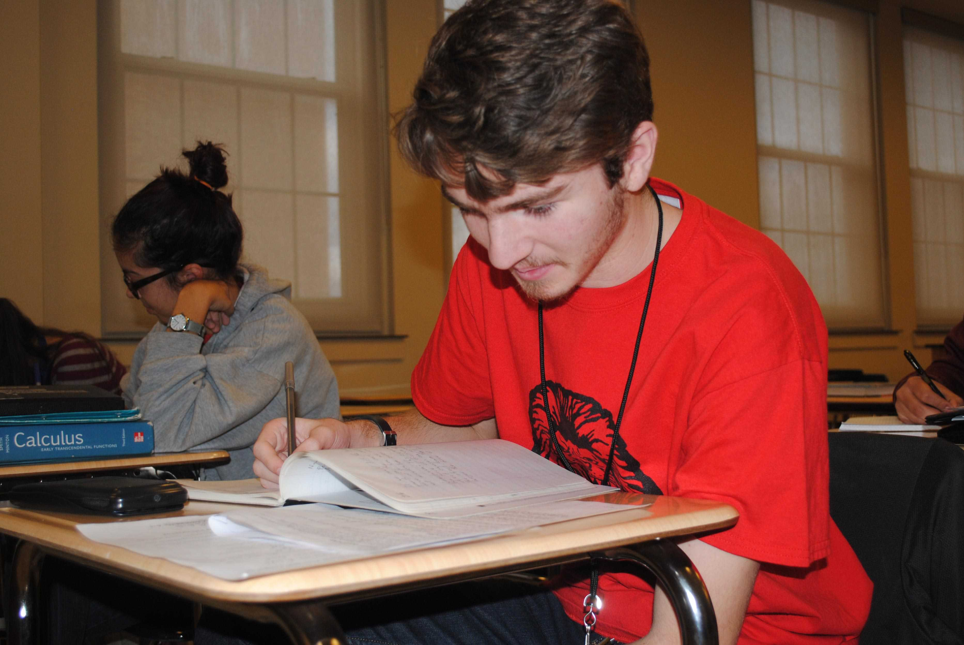"Josh Stueck, senior, concentrates on his lab in his AP Physics class. ""I enjoy physics but I prefer chemistry,"" Stueck said. ""The labs are more fun."" PHOTO BY KATHRYN FULLER"
