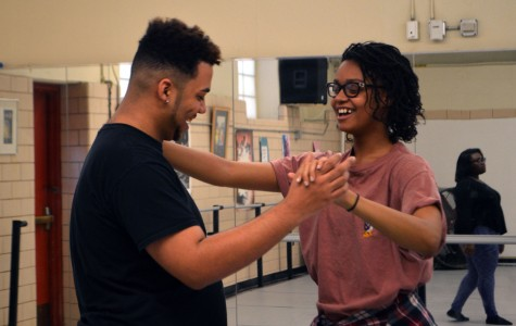 In the dance studio, male lead Joshua Mayfield, senior, learns the waltz for the song