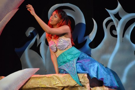 Singing a solo, Raven Bullard, junior, plays Ariel in the Little Mermaid musical. The production took place from Feb. 26 to 27 in the auditorium.