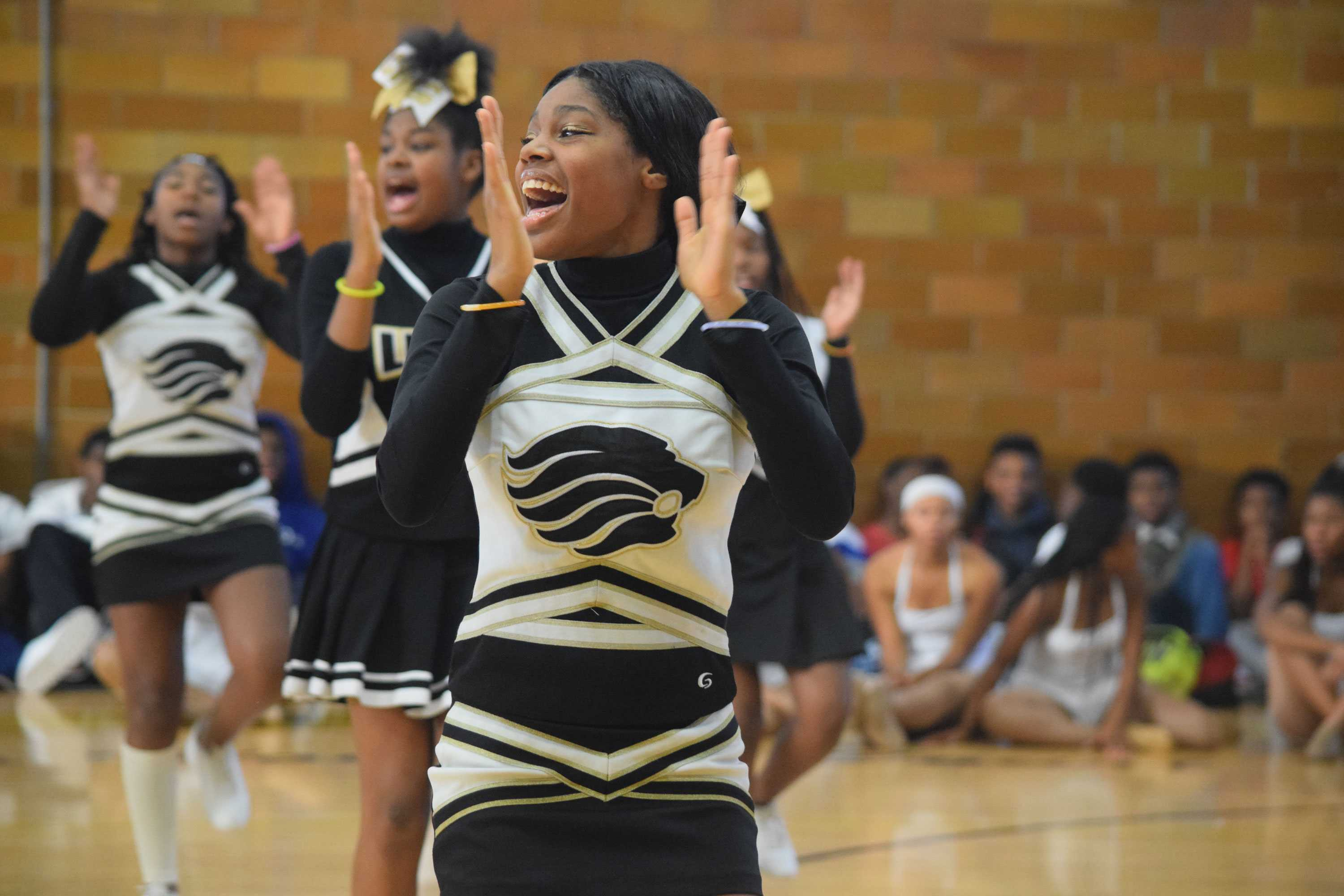 Chanting a tradtional U. City cheer, Jayla Robinson, senior, tries to pump up the crowd.