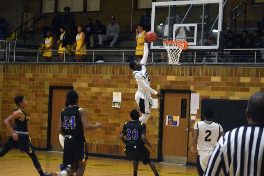 Senior, T.J. Crockett goes up for a dunk against Riverview on Thursday, Dec. 8.
