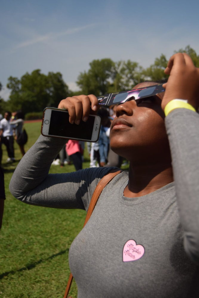 Students view solar eclipse