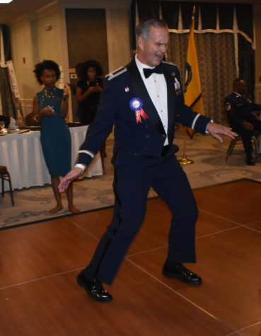 Col. Henson dances the Twist at Military Ball