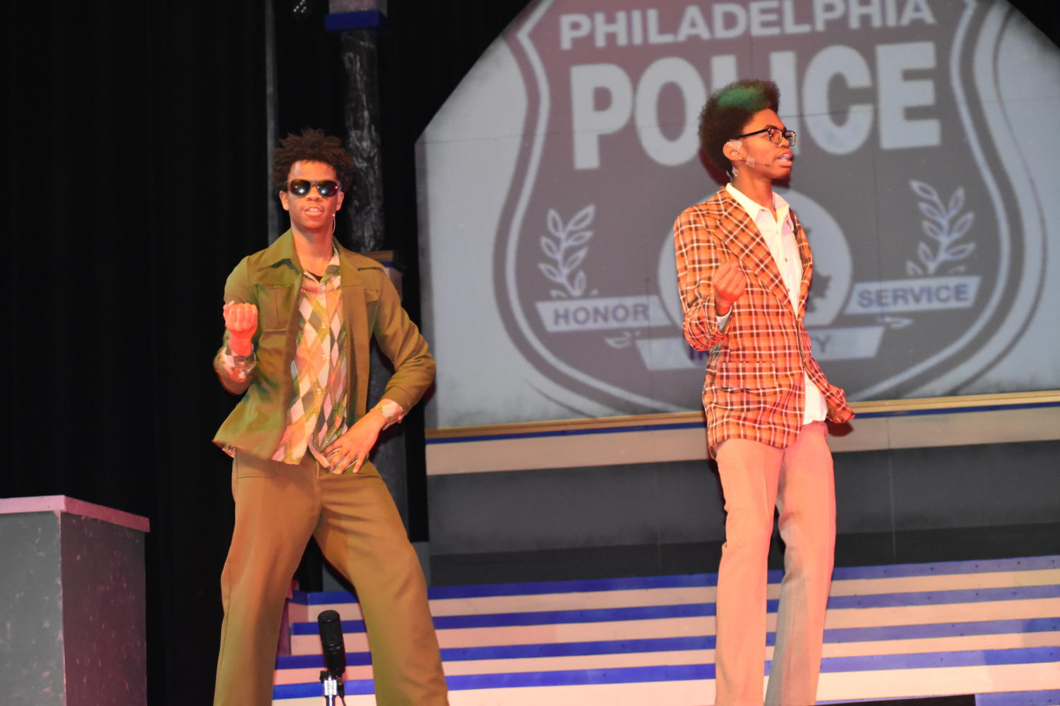Senior William Austin (left) and junior Marquess Pearson (right) dance along to the beat during the spring musical