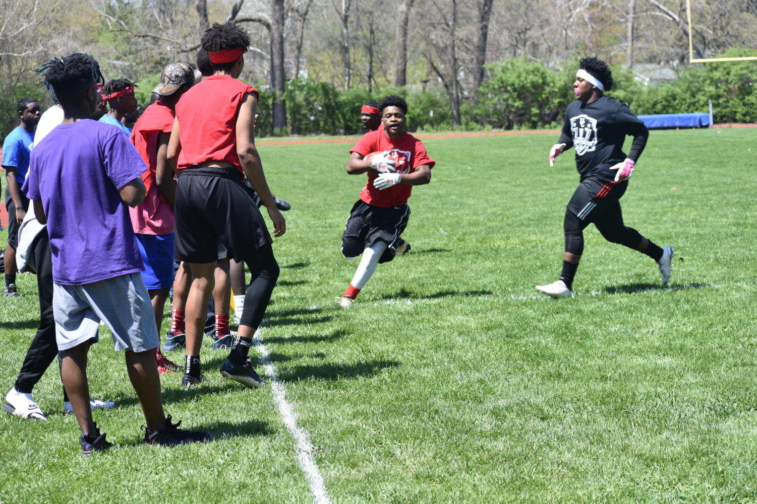 Givion Crawford, junior, makes a run up the sideline as the juniors played the seniors in flag football on Apr. 27.