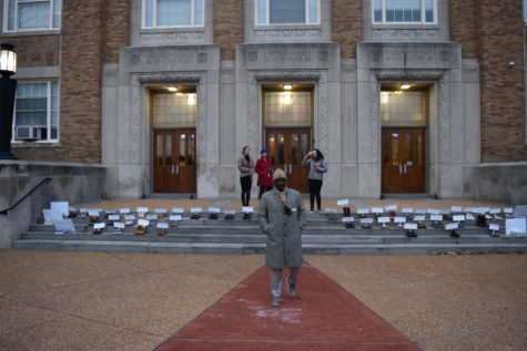 "Getting to school at 6 am to set up the display of shoes, Rowan Hoel and Leah Zukosky, seniors, along with Michael Peoples, principal, prepare for students to arrive. ""It took about two and a half hours [to set up],"" Hoel said. ""We started the day before, taping shoes. First we had to get all the shoes which took a week. For each name, we cut out a piece of poster board and wrote their name and age on it."""