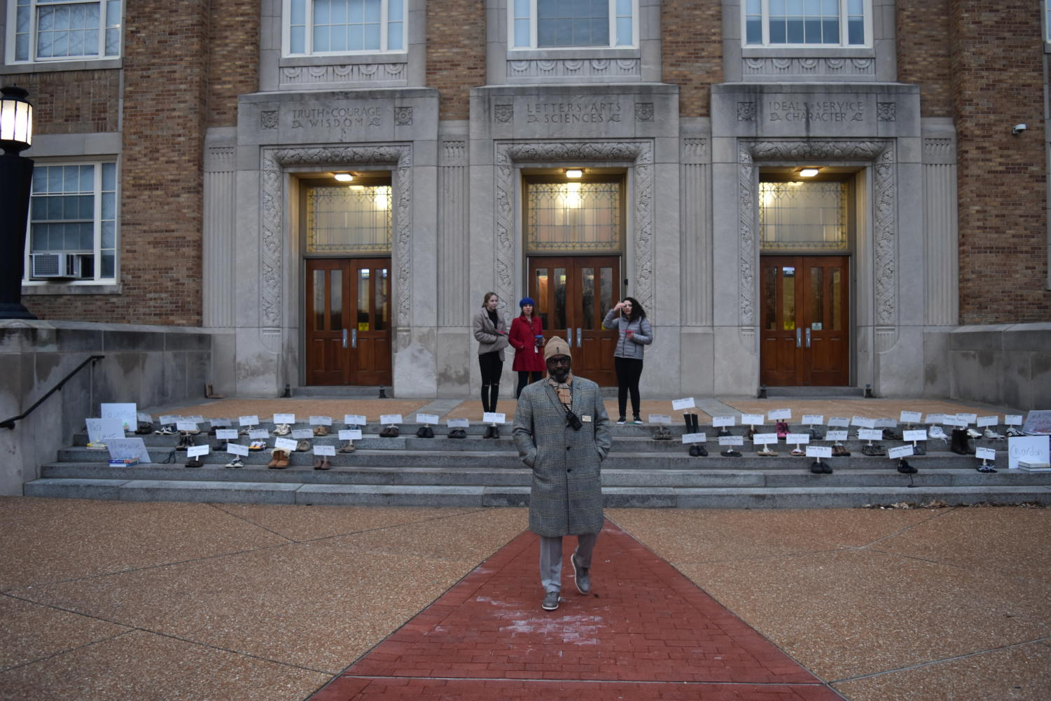 Getting to school at 6 am to set up the display of shoes, Rowan Hoel and Leah Zukosky, seniors, along with Michael Peoples, principal, prepare for students to arrive.