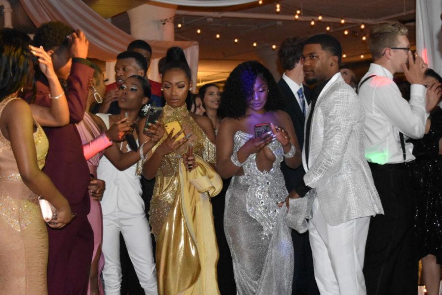 City lights shine on prom
