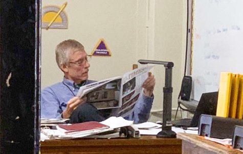 Mr. Ladage enjoys latest issue of U-Times