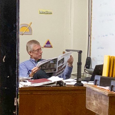 Mr. Ladage enjoys latest issue of U-Times