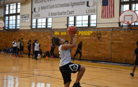 """At practice, Ayanna Williams, junior small forward, goes in for a lay up. """"A jump shot is my favorite shot because it's closer to the basket and easier to score,"""" Willams said. """" You are supposed to put your all into the shot."""""""