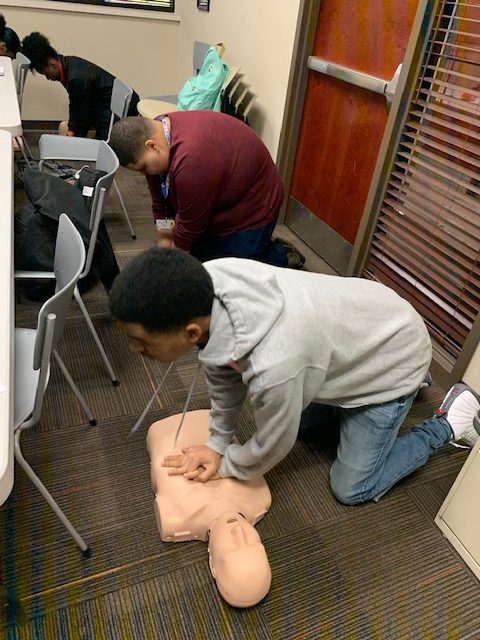+At+their+first+session%2C+Christian+Hollloway+and+Timothy+Dailey%2C+seniors%2C+perform+CPR+on+a+dummy+as+part+of+their+physical+test+to+complete+their+CPR+certification.+%E2%80%9CSo+far+it%E2%80%99s+been+super+exciting+just+based+on+the+things+we%E2%80%99ve+been+told+we+will+do+and+the+responsibility+we+will+have%2C%E2%80%9D+Dailey+said.