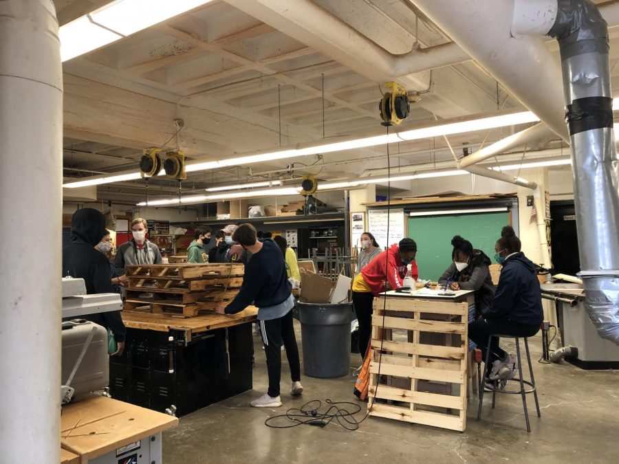 Black Academy students work on building a part of their courtyard.